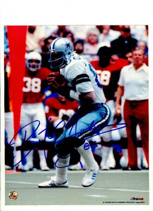 "Butch Johnson Dallas Cowboys Autographed 8"" x 10"" White Jersey Photograph with ""86"" Inscription (Unf"