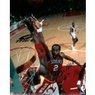 "Moses Malone ""In the Air"" Autographed Philadelphia 76ers 8"" x 10"" Photograph (Unframed)"