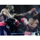 "Hasim Rahman Autographed ""Punching Lennox Lewis"" 16"" x 20"" Photograph (Unframed)"