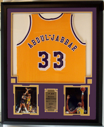 Kareem Abdul Jabbar Photo Collage with Autographed Los Angeles Lakers Road Basketball Jersey in a Deluxe Frame