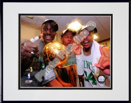 Kevin Garnett, Ray Allen, & Paul Pierce with the 2007-2008 NBA Champion trophy, Game Six of the NBA Finals; In the L
