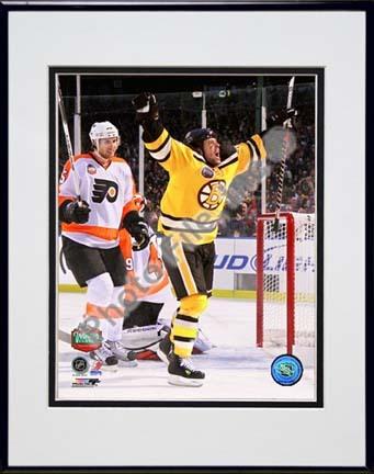 "Marco Sturm Game Winning Goal Vertical 2010 NHL Winter Classic Double Matted 8"" x 10"" Photograph in Black Anodized A"