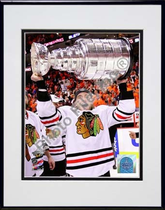 """Patrick Kane with the 2009 - 2010 Stanley Cup (#27) Double Matted 8"""" x 10"""" Photograph in Black Anodized Aluminum Fra"""