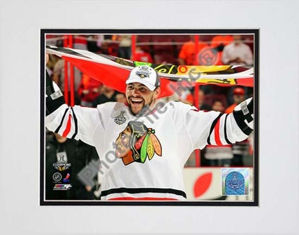 "Dustin Byfuglien with Chicago Blackhawks Flag 2010 Stanley Cup Finals (#35) Double Matted 8"" x 10"" Photograph (Unfra"