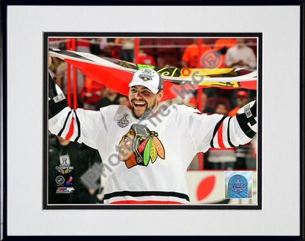 "Dustin Byfuglien with Chicago Blackhawks Flag 2010 Stanley Cup Finals (#35) Double Matted 8"" x 10"" Photograph in Bla"
