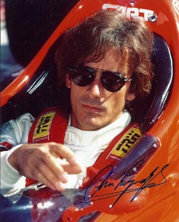 "Arie Luyendyk Autographed ""Racing"" 8"" x 10"" Photograph (Unframed)"