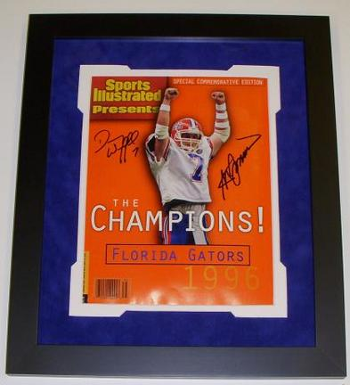 Both QB Danny Wuerffel and Coach Steve Spurrier of the NCAA Florida Gators have hand signed this Commemorative Sports Illustrated (Full Magazine-not just the cover) with Blue sharpie pens. This Commemorative Sports Illustrated came out in 1996 and was available only in Florida, for a limited time, which makes it even more special that it's signed by both champions and Heisman Trophy Winners! The Black custom wood frame measures 13x15 inches, and the double matting consists of a Blue Suede top matting over a White bottom mat. Conservation Clear glass was used on this fine piece to protect the autograph from fading due to UltraViolet Rays. This custom made frame is ready to hang on the wall! This item comes with a Real Deal Memorabilia Certif