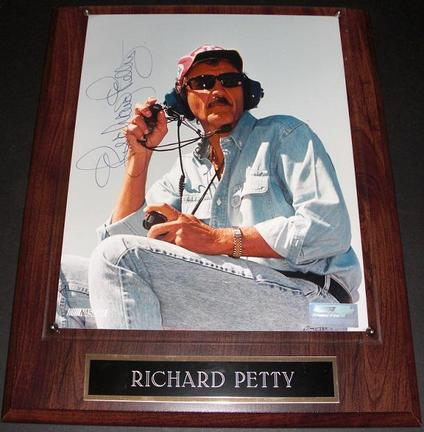 """Richard Petty """"Sitting"""" Autographed Racing 8"""" x 10"""" Photograph on a wall plaque"""