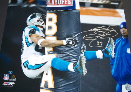 "Steve Smith Autographed ""Hugging the Bears Goalpost"" 16"" x 20"" Photograph (Unframed)"